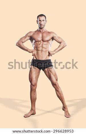 muscle man, bodybuilding athlete full body portrait - stock photo