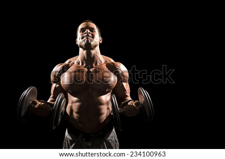 Muscle man doing bicep curls - stock photo