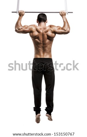 Muscle man in studio making elevations, isolated over a white background - stock photo