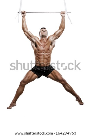 Muscle man in studio making elevations, isolated over a white ...