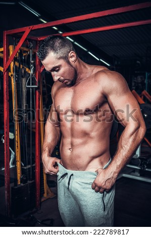 muscle man who is posing - stock photo