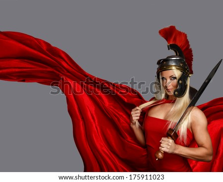 Muscled blonde in a centurion helmet - stock photo