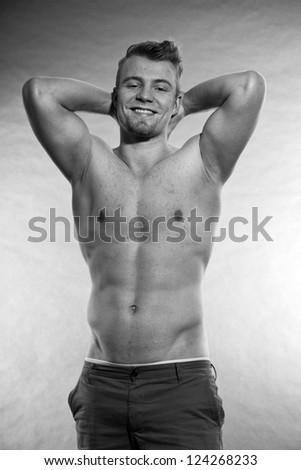 Muscled fitness man. Black and white studio shot. - stock photo