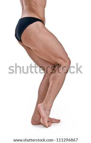 Muscled legs of a male athletic model on white background - stock photo
