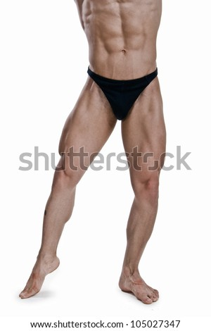 Muscled legs of a male model on white background - stock photo