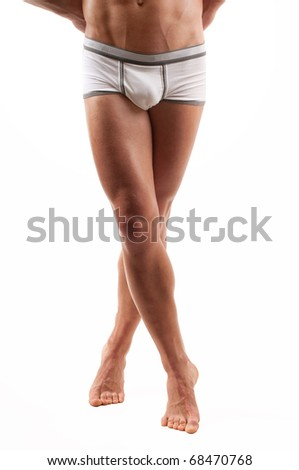 Muscled male legs on isolated white - stock photo