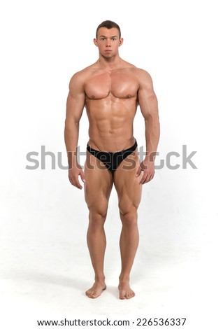 Muscled male model on white background  - stock photo