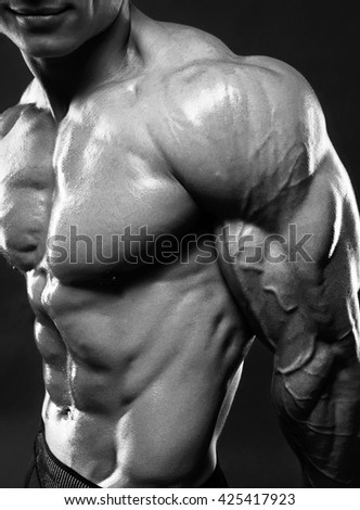 Muscled male model showing his biceps - stock photo
