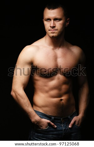 Muscled male posing - stock photo