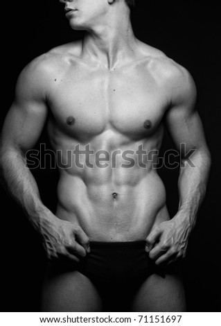 Muscled male torso in black and white - stock photo