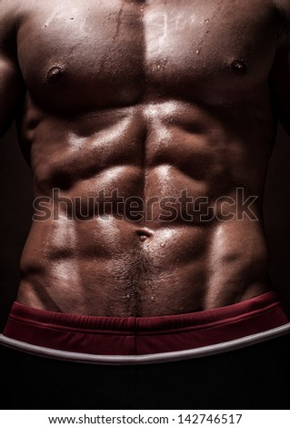 Muscled male torso with six pack - stock photo