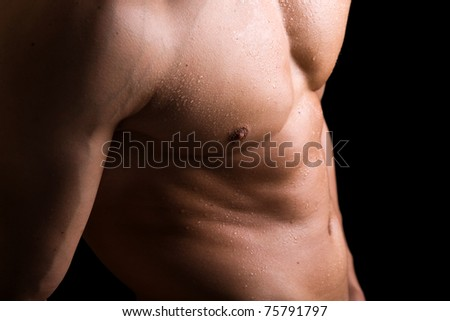 Muscled torso of a healthy young man - stock photo