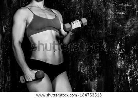 Muscled woman with barbells  - stock photo