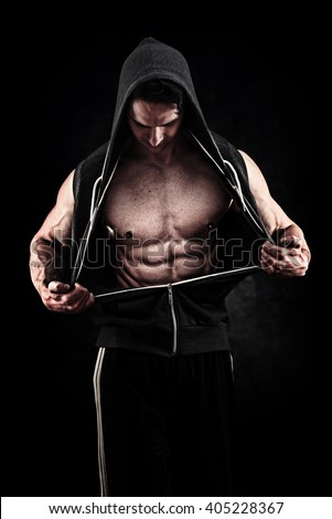 Muscular and fit young bodybuilder fitness male model posing over grunge background - stock photo