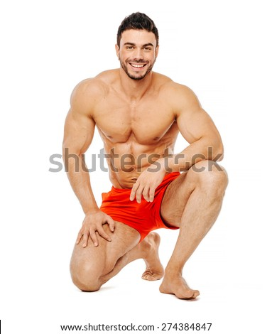 Muscular and handsome man on one knee isolated on white background - stock photo