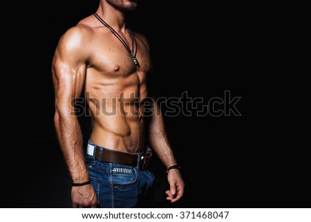Muscular and sexy torso of young man in jeans - stock photo