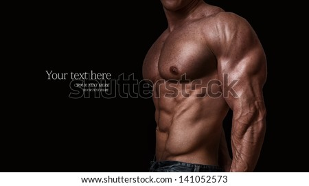 Muscular and sexy torso of young man, isolated on black background - stock photo