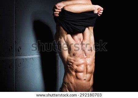 Muscular and sexy torso of young sport man. Attractive bodybuilder body with perfect abs, chest, bicep, triceps - stock photo