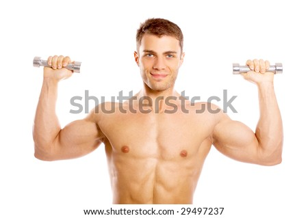 Muscular and tanned male during exercising with dumbbells - stock photo