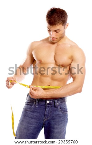 Muscular and tanned man is being measured - stock photo