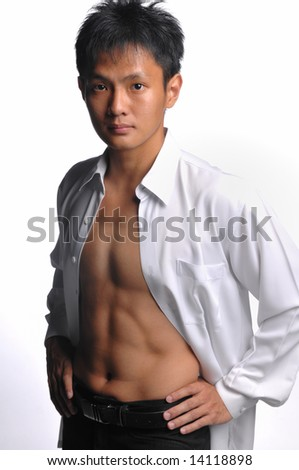 muscular asian business man - stock photo