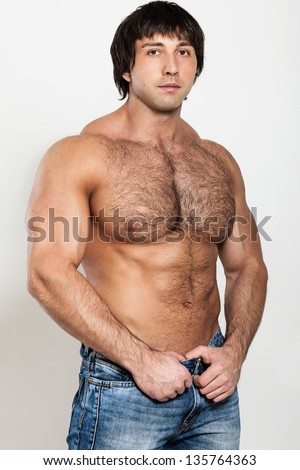 Muscular attractive young man with naked torso - stock photo