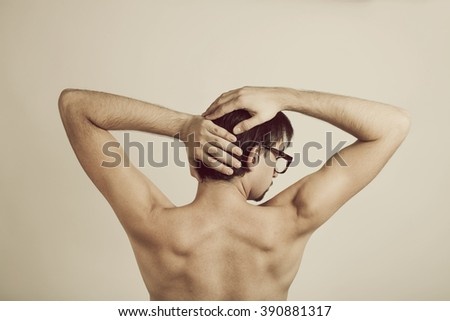 Muscular back of young man wearing glasses on white - stock photo