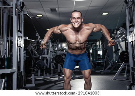 Muscular bodybuilder guy doing exercises workout in gym - breast muscles - stock photo