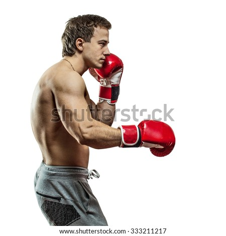 Muscular boxer is boxing. Isolated on white background. - stock photo