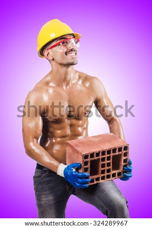 Muscular builder with bricks on white - stock photo