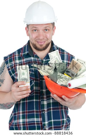 Muscular caucasian manual worker holding a hardhat full of cash, isolated over white - stock photo
