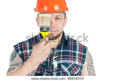 Muscular caucasian manual worker with a paint brush, isolated over white - stock photo