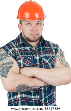 Muscular caucasian manual worker with tattoos, isolated over white - stock photo