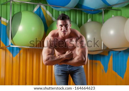 Muscular guy in fitness club - stock photo