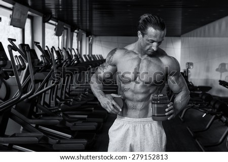 Muscular Handsome Bodybuilder With Pills And Dope For Copy Space - stock photo