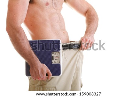 Muscular male body and scale isolated on white background. Health care  weight loss. - stock photo