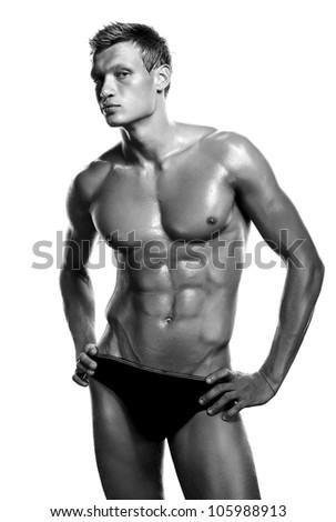 Muscular male torso of bodybuilder on white background - stock photo