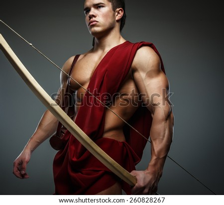 Muscular male with bow. - stock photo