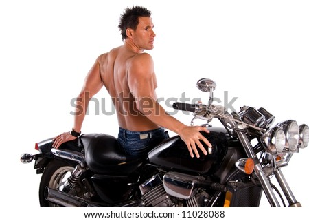 Muscular man and motorcycle. - stock photo