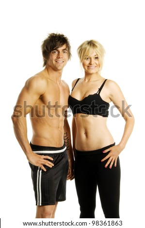 Muscular man and pretty blonde woman in athletic gym wear - stock photo