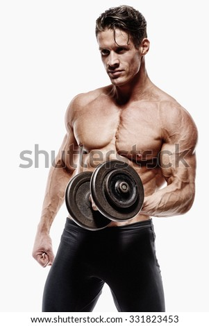Muscular man bodybuilder. Man posing on a white background, shows his muscles. Bodybuilding, posing, white background, muscles - the concept of bodybuilding. - stock photo