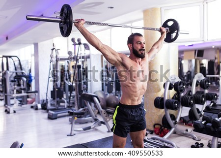 Muscular Man Doing Heavy Deadlift Exercise. Depth of field, motion blur, selective focus, focus on man's chest  - stock photo