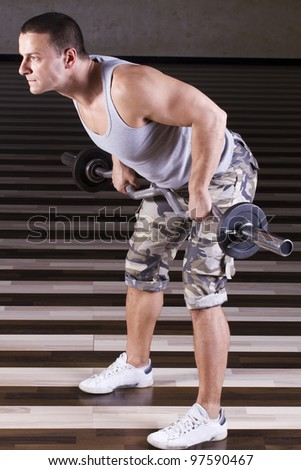 Muscular Man Doing Heavy Exercise - stock photo