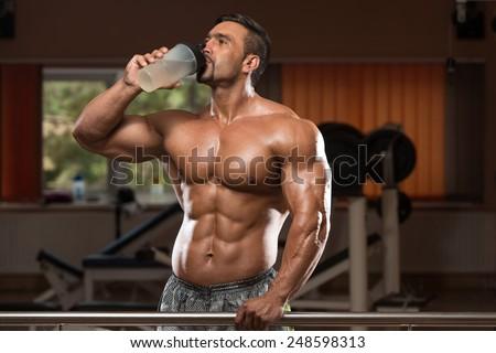 Muscular Man Drinking A Water Bottle - stock photo