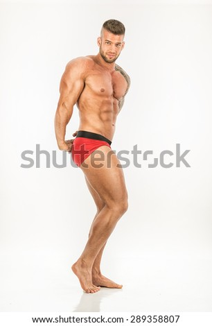 Muscular man - front view - on white background - stock photo