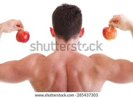 Muscular Man holding red apples back view isolated on white. Athletic sexy male body builder with fruits - stock photo