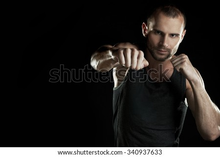 muscular man, hour boxer, black background, horizontally - stock photo