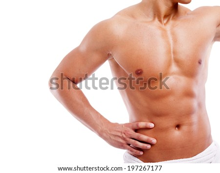 Muscular man in towel, isolated on white background - stock photo