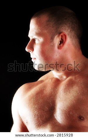MUSCULAR MAN. ISOLATED ON BLACK. SHOT IN STUDIO. - stock photo