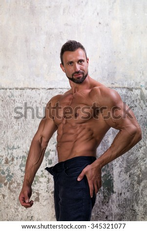 Muscular man on concrete background - stock photo